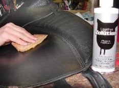 Applying leather conditioner to treeless saddle